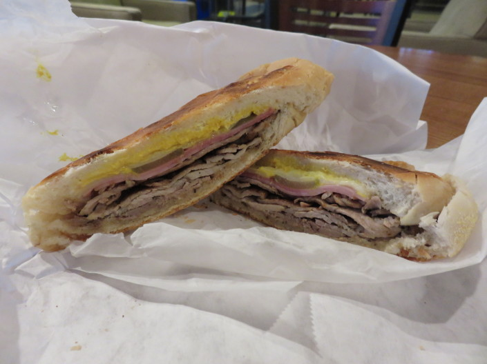 Cubano - Roasted Pork, Ham, Swiss Cheese, Mustard, Pickles on pressed bread