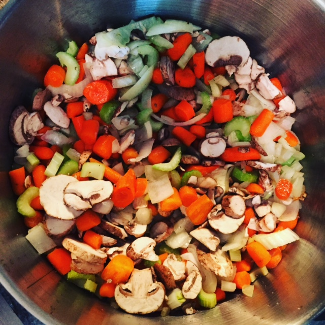 Saute the mirepoix (plus mushrooms) and garlic to make the base of your soup.